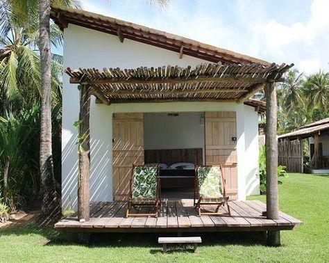 casa de praia simples com deck de madeira