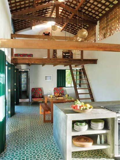 cozinha integrada com a area social da casa de praia