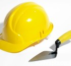 Bricklayer's hard hat and trowel