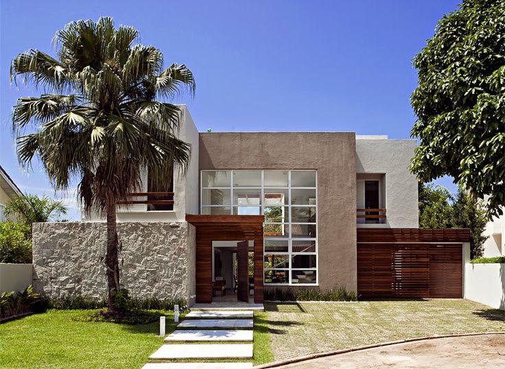 35 modelos de fachadas decoradas com pedras for Casa minimalista rustica